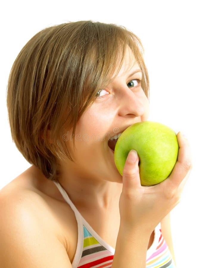 苹果尖酸的逗人喜爱的女孩绿色 库存照片