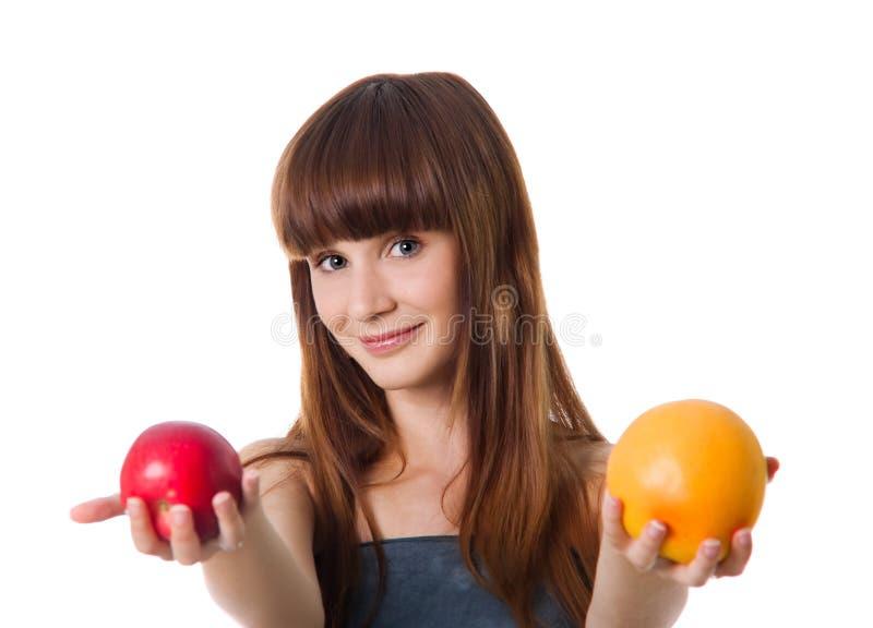 苹果暂挂橙色俏丽的妇女 库存照片