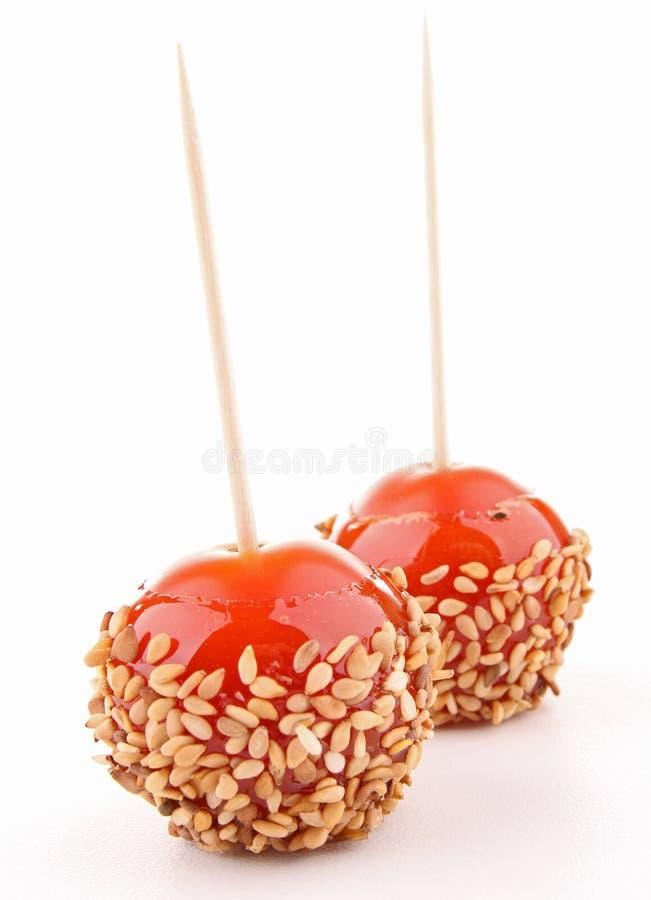 苹果查出象奶糖蕃茄 库存图片