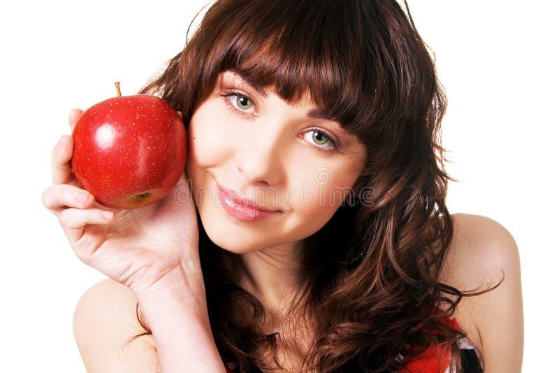 苹果浅黑肤色的男人相当红色成熟 图库摄影