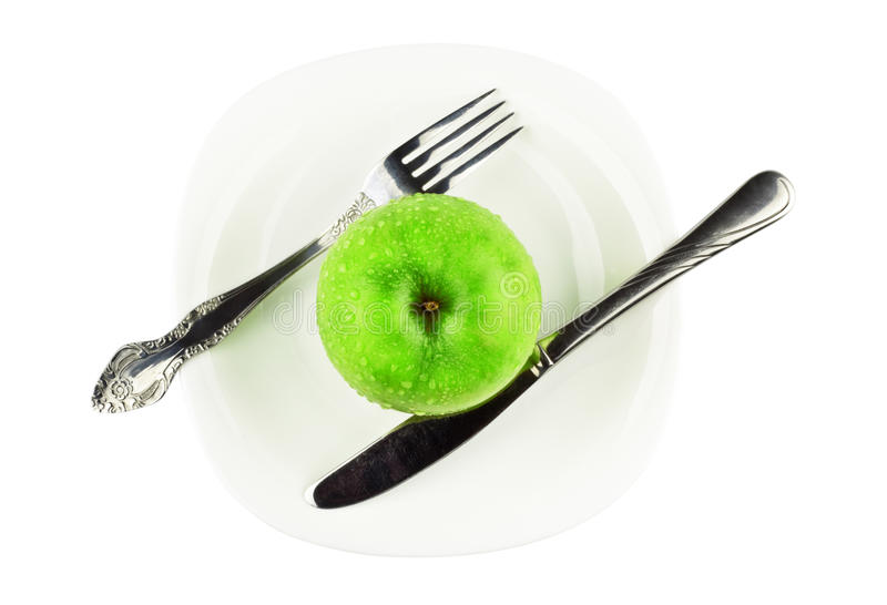 苹果盘叉子绿色刀子白色 免版税库存照片