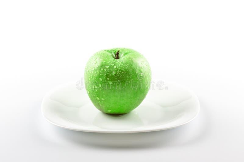 苹果盘绿色白色 库存照片