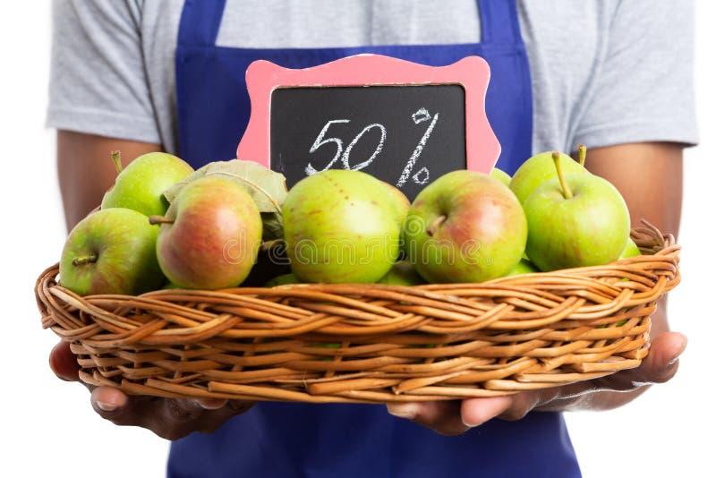 苹果篮子在百分之五十的由雇员拖延了 免版税库存照片