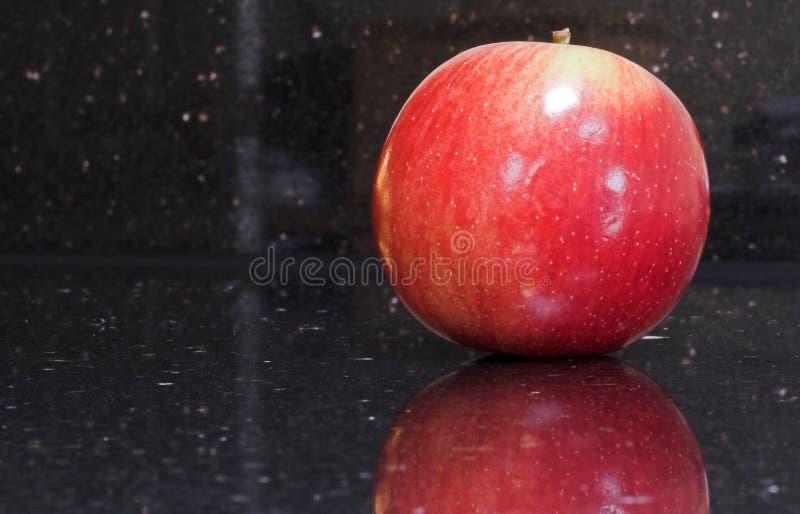 苹果红色发光 库存图片