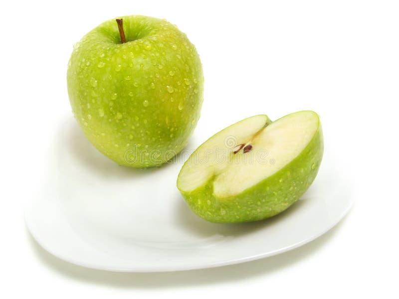 苹果绿半全部 免版税库存图片