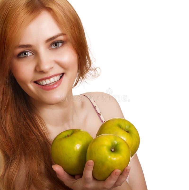 苹果绿愉快微笑三个妇女年轻人 免版税库存照片