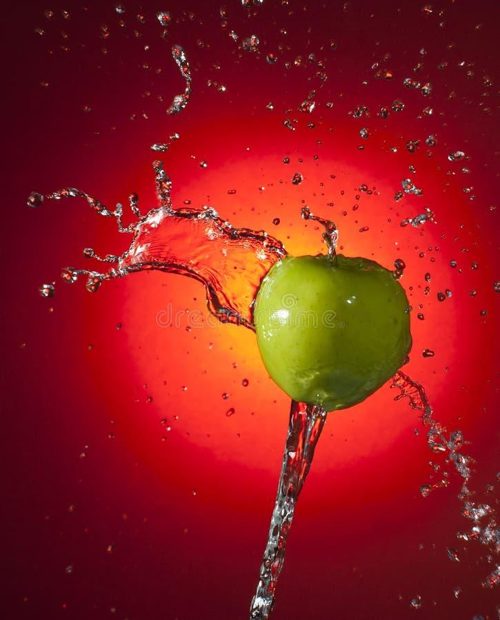 苹果绿的飞溅 免版税库存照片