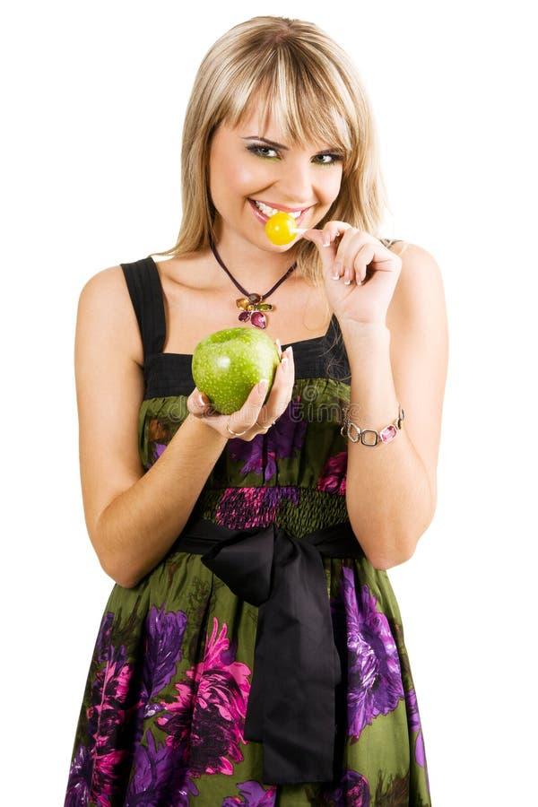 苹果美丽的糖果妇女年轻人 免版税图库摄影
