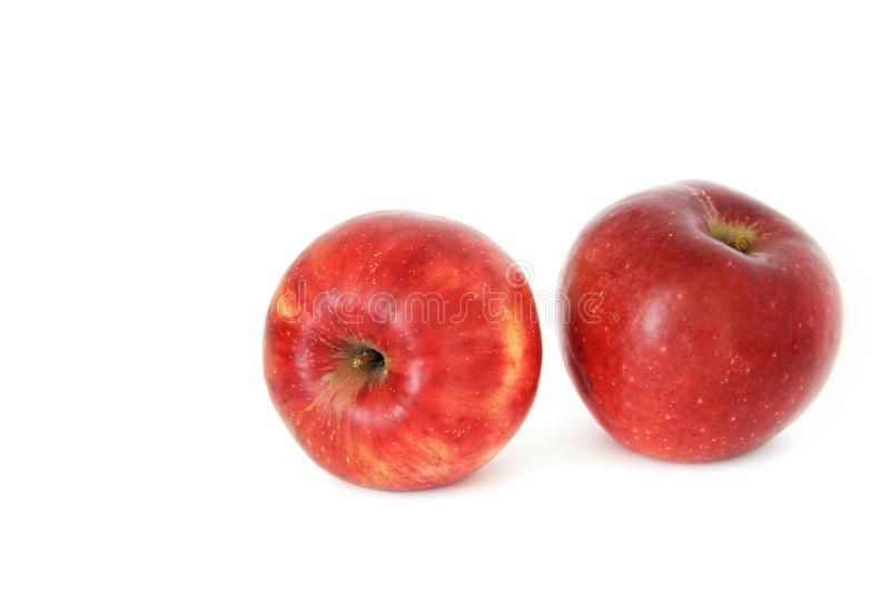 苹果背景关闭白色的一个红色 免版税库存图片