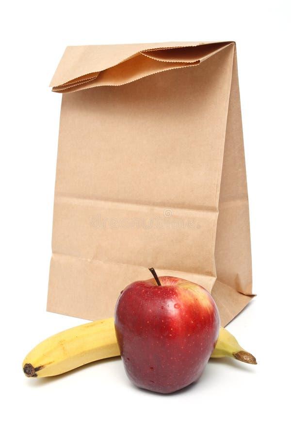 苹果袋子褐色午餐纸张红色 库存照片