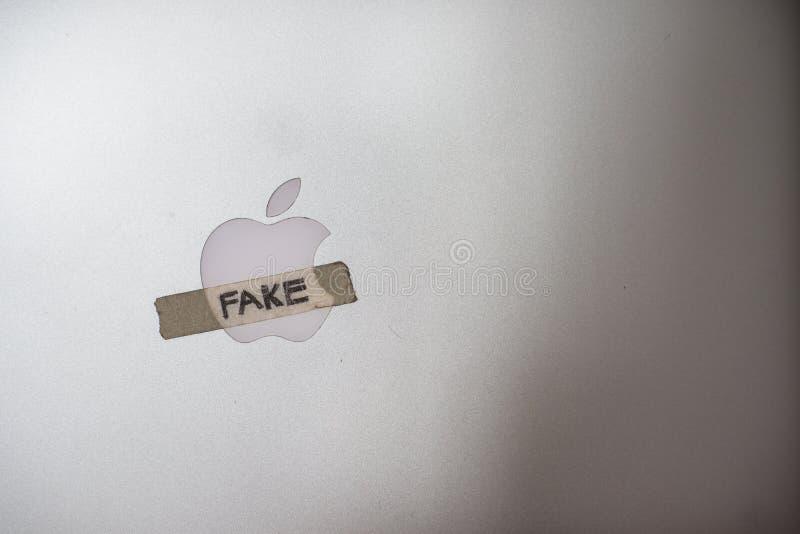 苹果计算机与磁带书面假词的公司商标 免版税库存图片