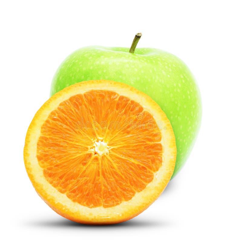 苹果计算机和桔子 库存照片