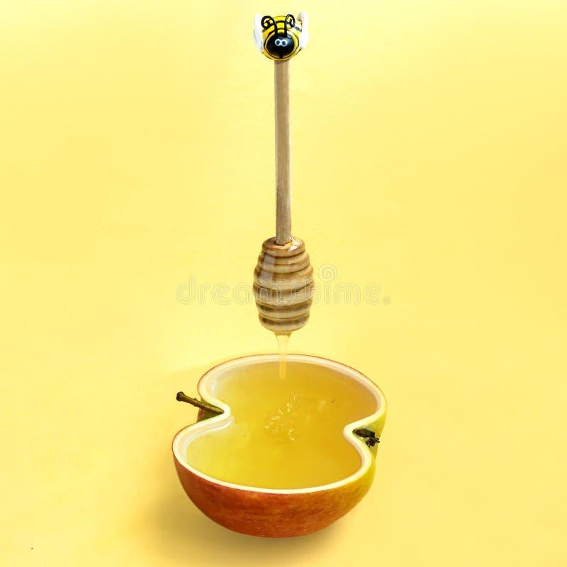 苹果计算机和蜂蜜是犹太新年犹太新年的标志 库存照片