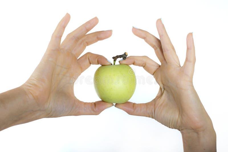 苹果计算机在手中女孩 免版税图库摄影