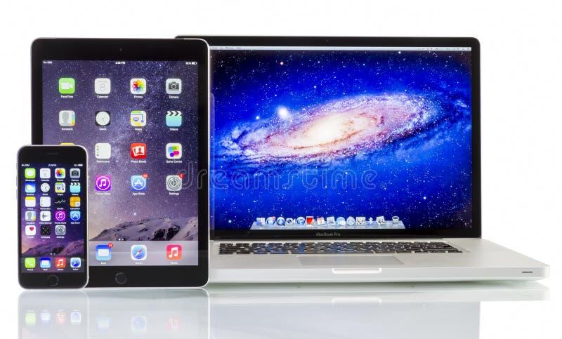 苹果计算机赞成Macbook, iPad空气2和iPhone 6 免版税图库摄影