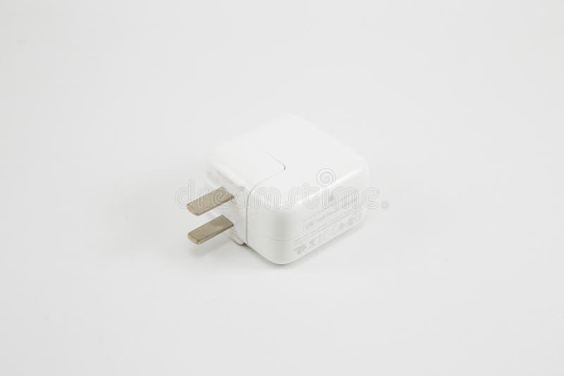 苹果计算机USB充电器适配器 免版税库存照片
