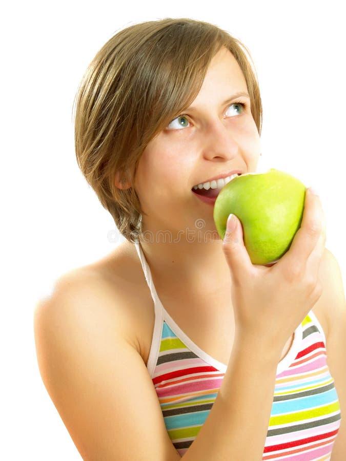 苹果逗人喜爱吃新女孩绿色 图库摄影