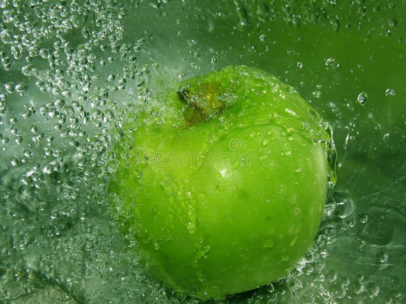 苹果飞溅 免版税库存照片