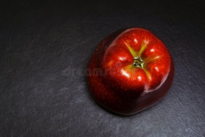 苹果黑色红色 库存照片
