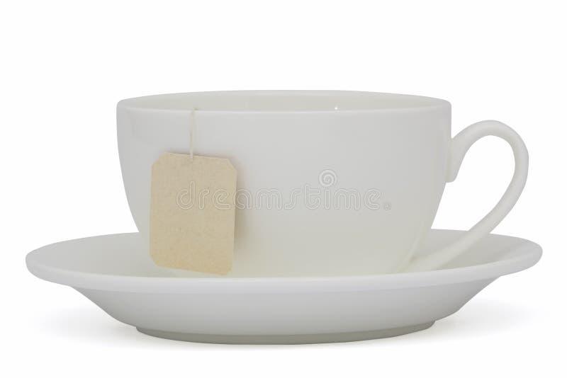 茶与茶包(空白的标签)的,在白色 免版税库存图片