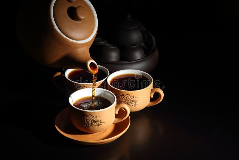 茶杯有茶壶的 库存照片