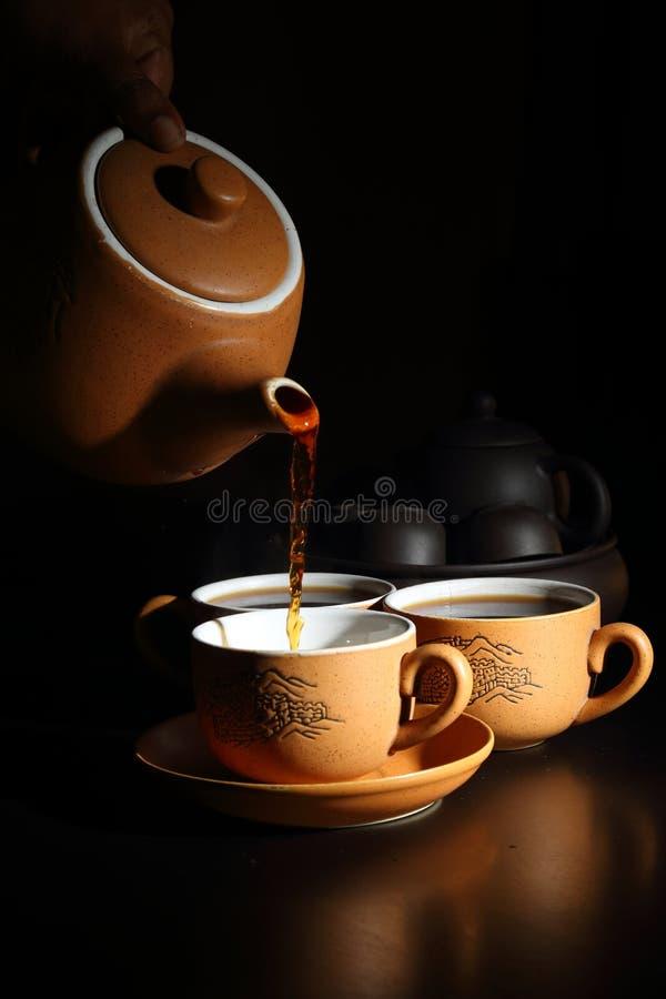 茶杯有茶壶的 免版税库存图片