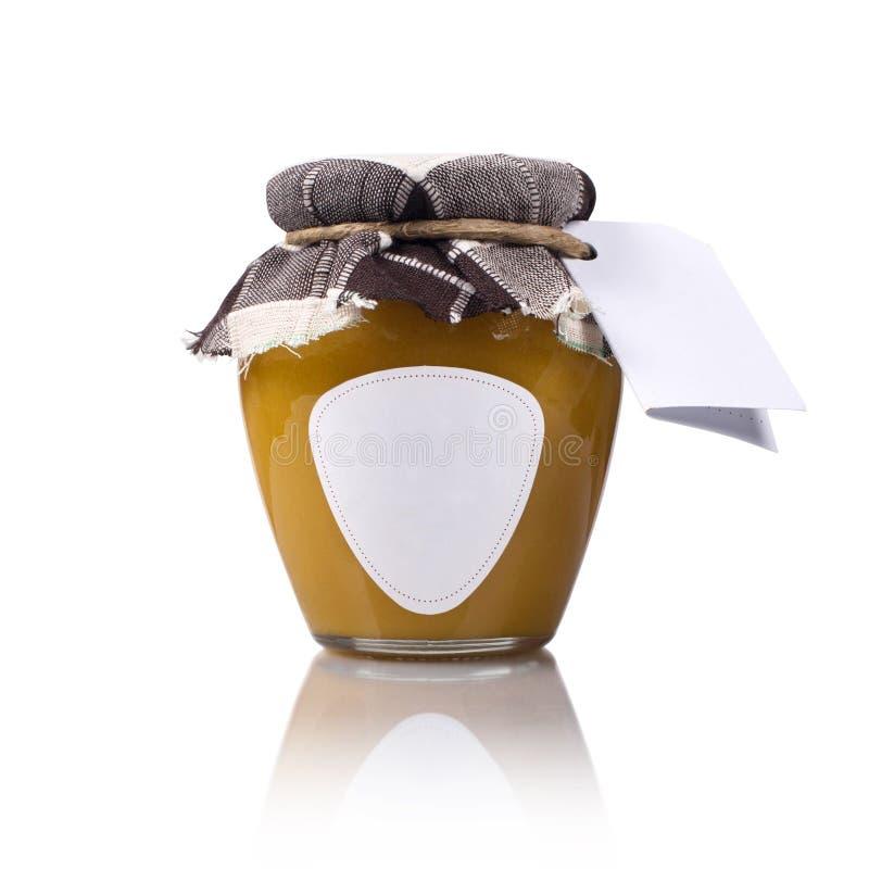 草甸有空白的标签和礼节的蜂蜜瓶子 图库摄影