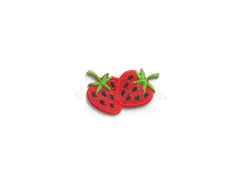 草莓导电线在白色背景的贴纸衣裳 免版税库存照片