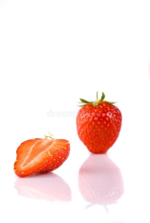 草莓的充分和一半 免版税库存照片