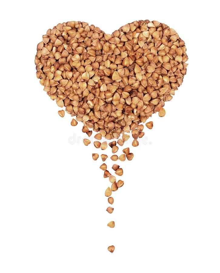 荞麦仁堆以心脏的形式 库存照片