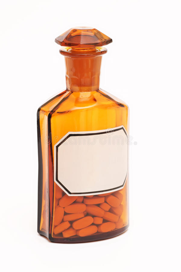 药房、玻璃瓶和药片,医学 免版税库存照片