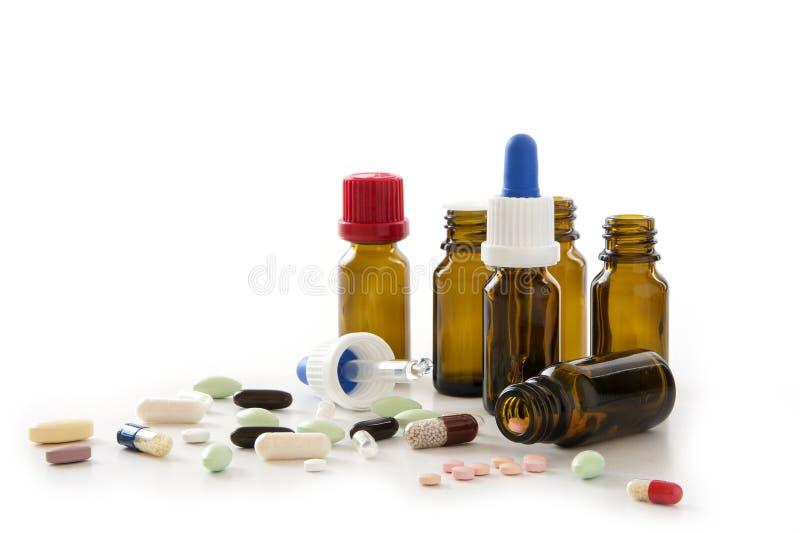 药片、胶囊和药房瓶隔绝与在w的阴影 库存图片