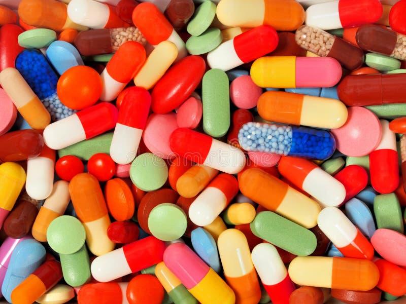 从药片和胶囊的背景 库存照片