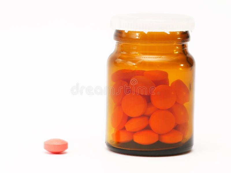药片,在蓝色背景,药房,医学的胶囊 免版税库存图片