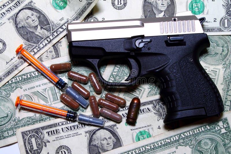 药物、金钱和枪-暴力 免版税库存图片