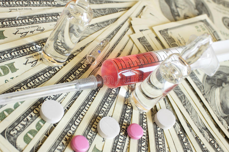 药物和货币。 医疗背景 库存图片