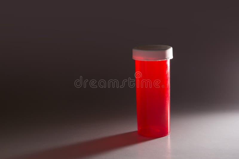 药瓶的黑暗的喜怒无常的照片 库存照片