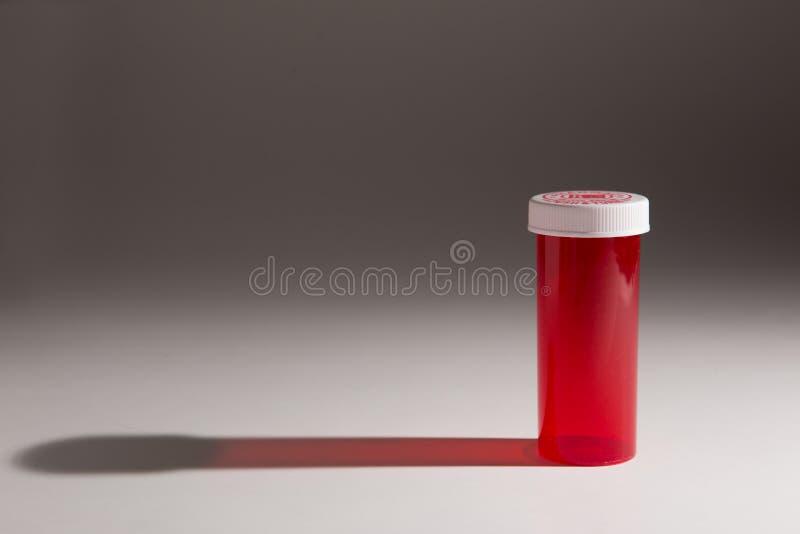药瓶的黑暗的喜怒无常的照片 免版税库存照片