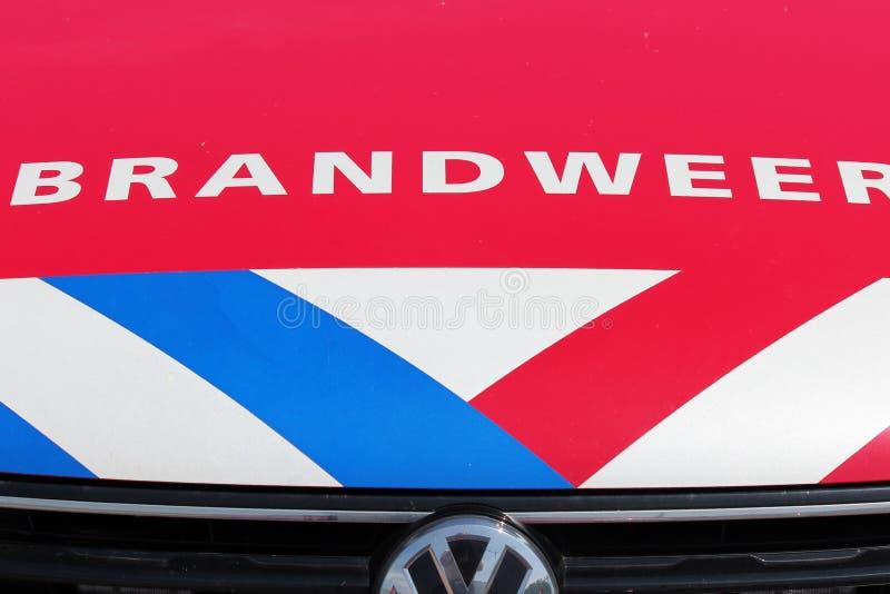 荷兰消防队员旅团的商标在有名字Brandweer在荷兰和红色,白色蓝色脱模的荷兰在红色加州 图库摄影