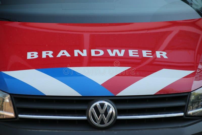 荷兰消防队员旅团的商标在有名字Brandweer在荷兰和红色,白色蓝色脱模的荷兰在红色c 免版税库存照片