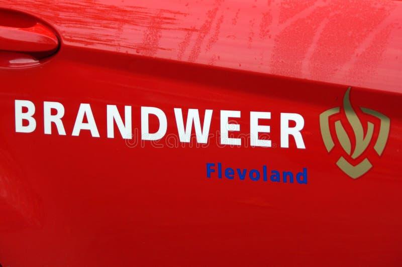 荷兰消防队引擎门-消防队员 免版税库存照片