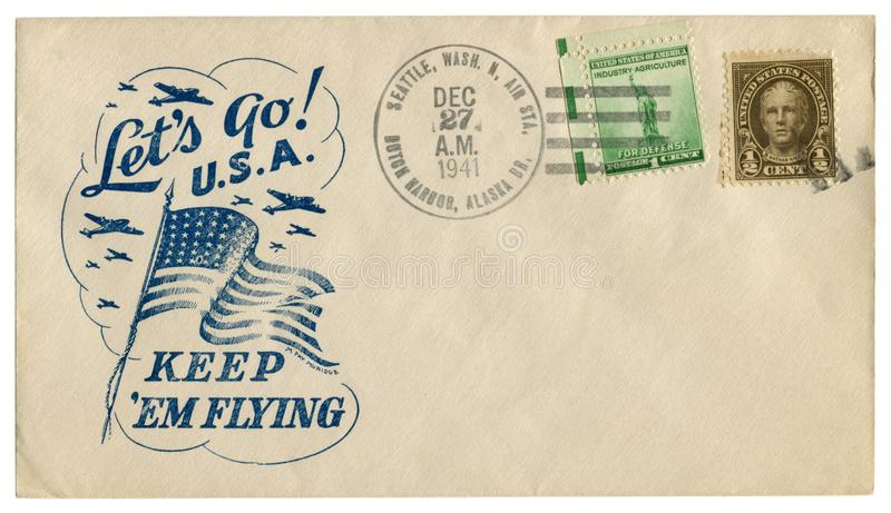 荷兰港,阿拉斯加,美国- 1941年12月27日:美国历史信封:有爱国封印的盖子让我们走U S A 保留他们飞行a 免版税库存照片