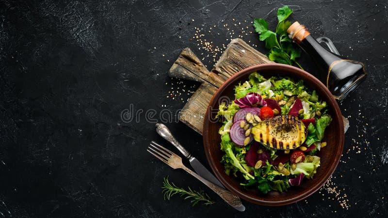 ?? 莴苣、甜菜、鲕梨和南瓜籽 库存图片