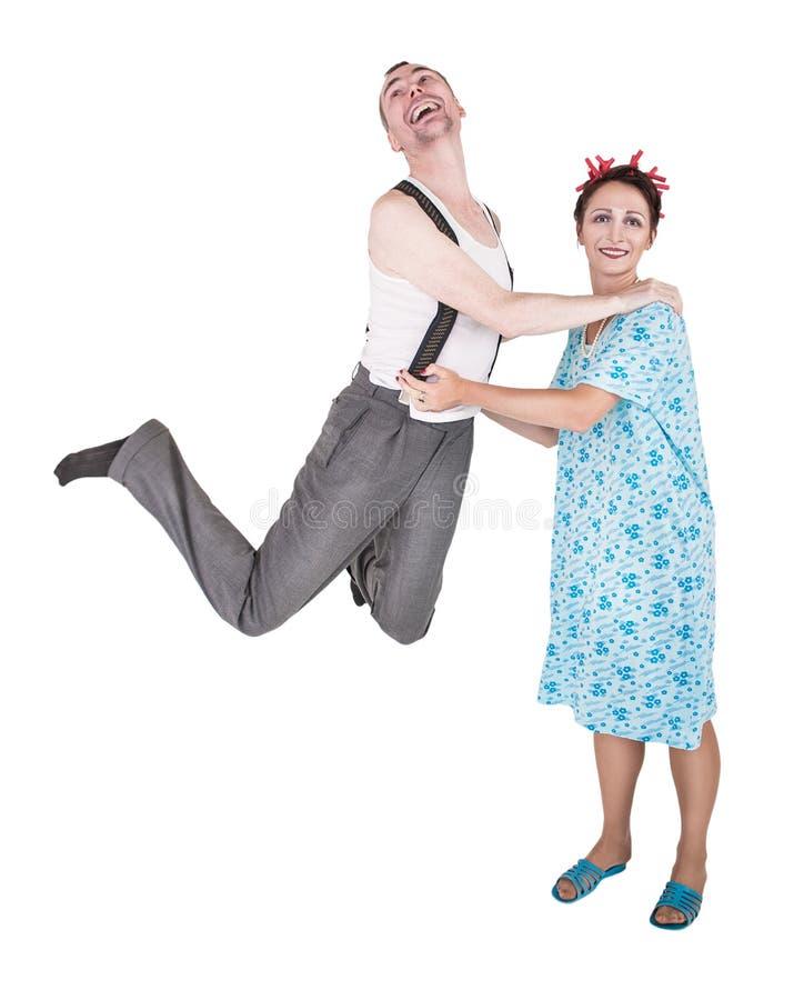 获得滑稽的家庭的夫妇被隔绝的乐趣 免版税库存照片
