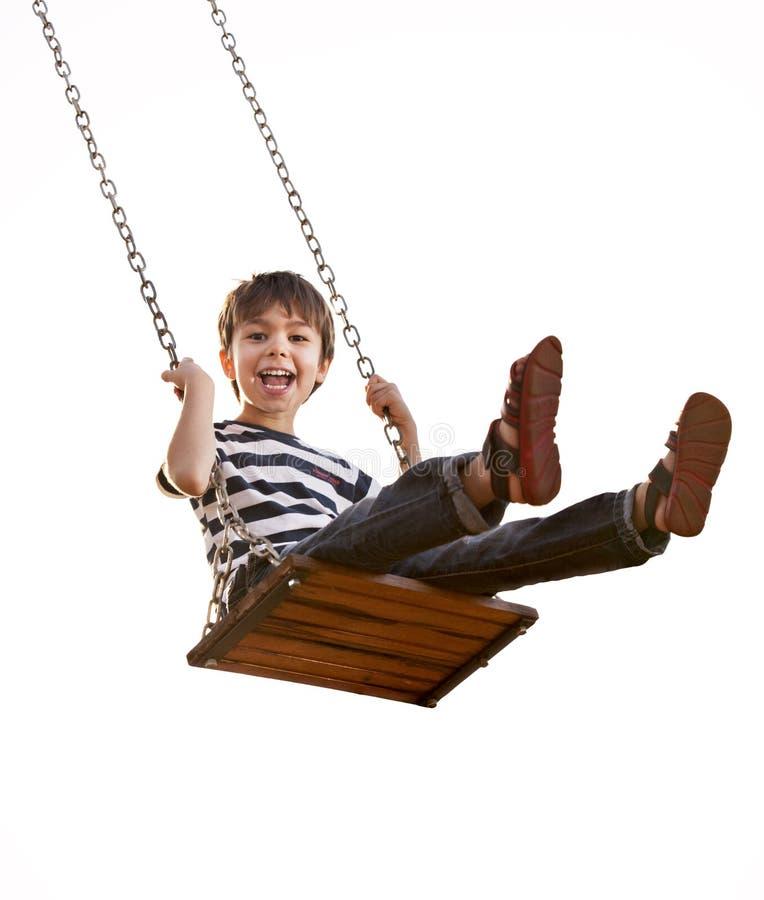 获得的男孩在摇摆的乐趣 免版税库存照片