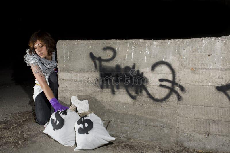 获得货币大袋窃贼 免版税图库摄影