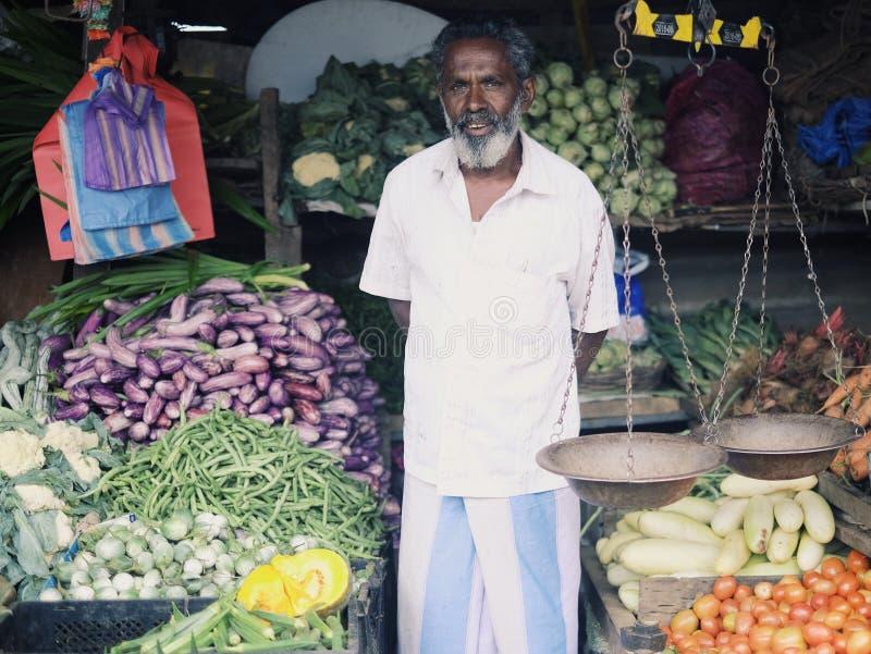 菜摊位的所有者在斯里兰卡 库存照片