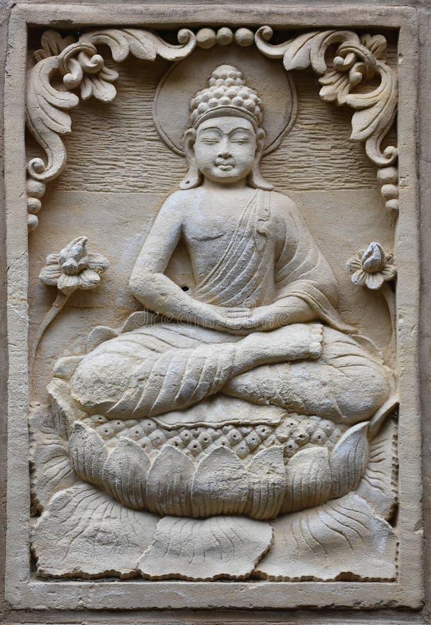 菩萨浅浮雕石雕塑  免版税库存照片