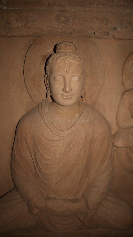 菩萨的雕象Jaulian的破坏了佛教徒修道院,哈里普尔,巴基斯坦 联合国科教文组织世界遗产名录站点 免版税库存照片