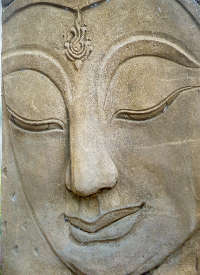 菩萨雕象面孔 免版税图库摄影